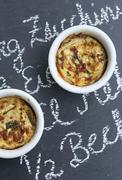 Two Individual Zucchini Casseroles on Chalkboard Surface Stock Photos