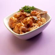 A Bowl of Shrimp in Sherry Sauce with Bacon Stock Photos