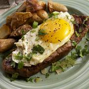 Stock Photo of Bife a Cavalo; Brazilian Steak Topped with a Fried Egg; Potatoes