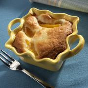 Individual Peach Cobbler in a Yellow Baking Dish Stock Photos
