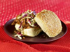 Barbecue Pulled Pork Sandwich with Cole Slaw on Sesame Seed Bun Stock Photos