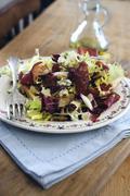 Gorgonzola and Bresaola salad on bruschetta - stock photo