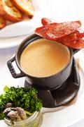A fondue made with gouda and porter cheese with Andouille sausage, broccolini Stock Photos