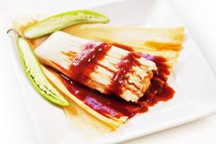 Spicy Tamale with Husk Peeled Open - stock photo