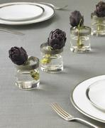 Table Setting with Artichokes in Glasses of Water - stock photo