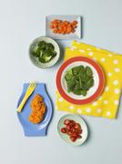 Stock Photo of Assorted Vegetables Containing Beta Carotene: Baby Spinach, Broccoli, Grape