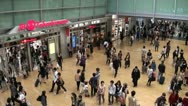 Stock Video Footage of Nagoya train station rush hour (escalators going down handheld zoom)