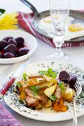 Smoked pork with root vegetables and beetroot - stock photo