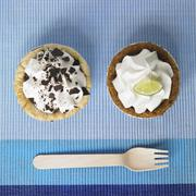 Two Mini Pies; Chocolate Cream and Key Lime; From Above - stock photo