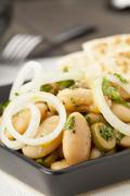 A white broad bean salad with olives and onions served with pita bread Stock Photos