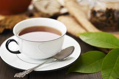 A cup of walnut leaf tea - stock photo