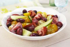 Heirloom Tomato and Olive Salad - stock photo