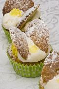 Fairy cakes decorated with vanilla cream and icing sugar Stock Photos