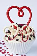 A cupcake decorated with hearts for Valentine's Day - stock photo