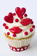 A cupcake decorated with red lips and hearts for Valentine's Day - stock photo