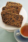 Spiced raisin cake with a cup of tea - stock photo