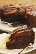 Spiced pear cake with ice cream Stock Photos