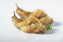 Marinated rabbit legs Stock Photos