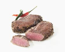 Two pepper steaks Stock Photos