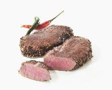 Two pepper steaks - stock photo