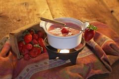 Creamy Raspberry Fondue with Fresh Strawberries and Raspberries Stock Photos