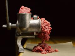 Stock Photo of Beef in a Meat Grinder