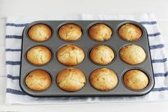 Peach muffin in a muffin tin Stock Photos