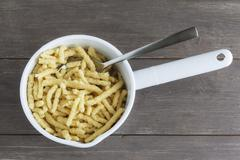 Spätzle (soft egg noodles) in a saucepan Stock Photos