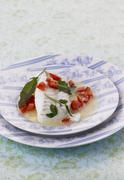 Poached cod with sage - stock photo