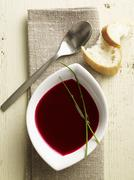 Cream of beetroot soup with bread - stock photo