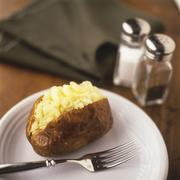Stock Photo of Baked Potato Split with Butter
