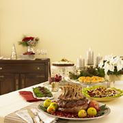Christmas Dinner Table with Crown Roast Pork - stock photo