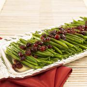Platter of Green Beans with Dried Cranberries for Christmas Dinner - stock photo