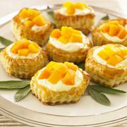 Peach and Cream Puff Pastries on a Platter - stock photo