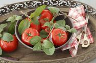 Stock Photo of Tomatoes and fresh basil