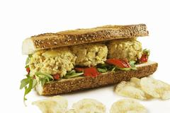 Curried Chicken Salad Sandwich with Potato Chips - stock photo