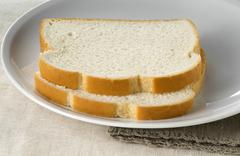 Two Slices of White Bread on a Plate Stock Photos