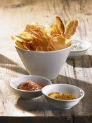 Potato chips with pepper salt, curry salt and celery salt Stock Photos
