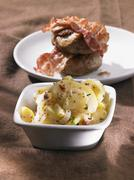Potato salad with meat balls and bacon Stock Photos