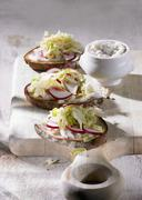 Brown bread topped with dripping and pointed cabbage salad Stock Photos