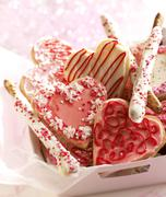 Box of Valentine's Cookies and Chocolate Covered Pretzel Rods - stock photo