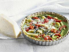 Stock Photo of Courgette and pepper quiche in a dish