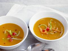 Sweet potato soup in bowls Stock Photos