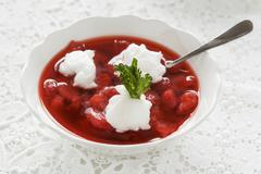 Cold strawberry soup with egg white dumplings - stock photo