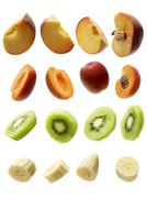 Peaches, apricots, kiwis and bananas Stock Photos
