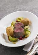 Venison fillets with potato croquettes, Brussels sprouts puree and lingonberries Stock Photos