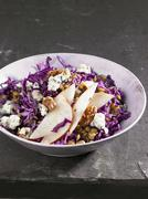 Red cabbage and lentil salad with pears, Roquefort and walnuts - stock photo