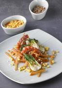 Sauteed prawns with carrots, bok choy and diced mango - stock photo