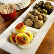 Three Part Serving Dish with Deviled eggs, Marinated Mushrooms and Olives; Bowl - stock photo