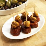 Small Dish of Chorizo and Mushroom Appetizers with Toothpicks Stock Photos